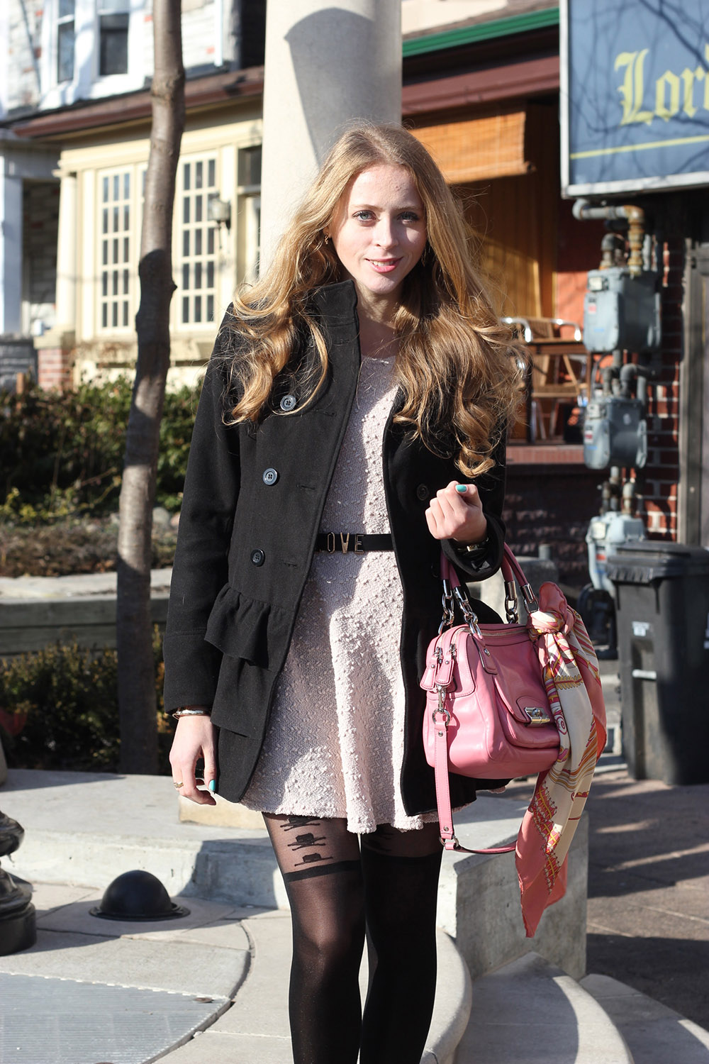 black jacket and pink dress and bag