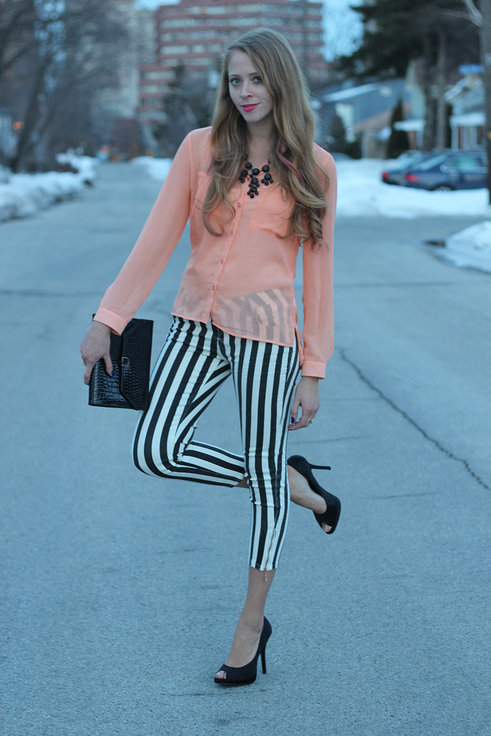 striped jeans and peach shirt