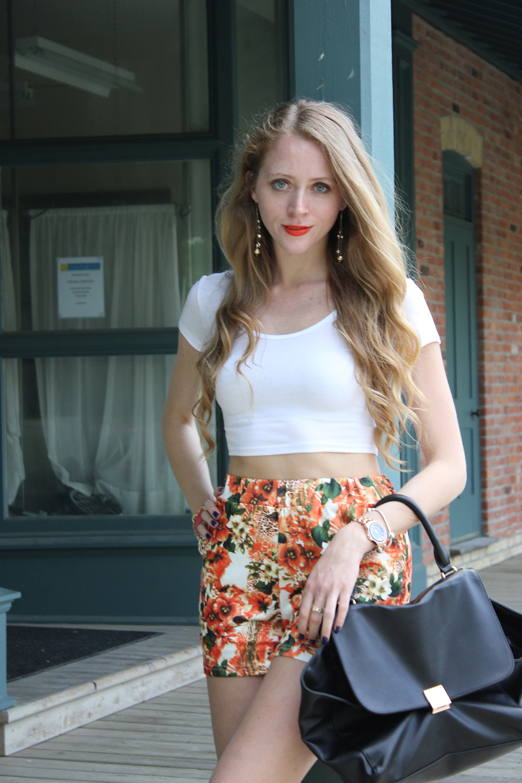 orange shorts black purse