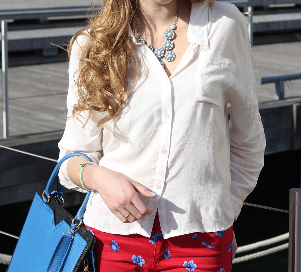 white blouse blue bag red pants
