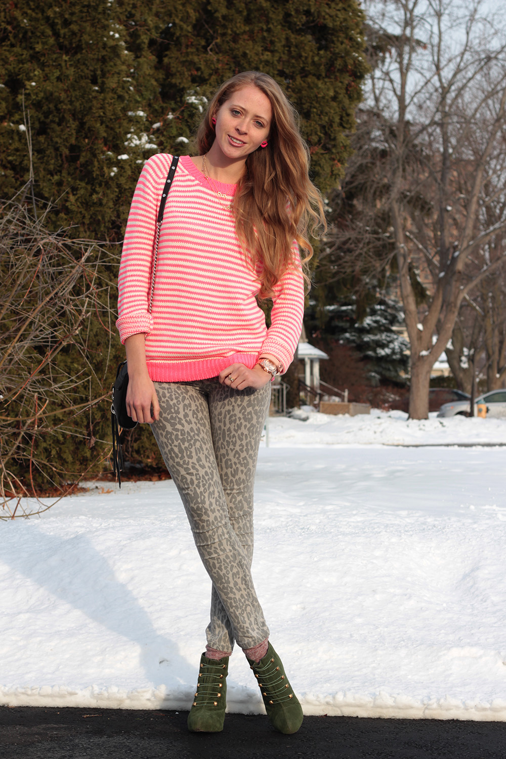 pink striped sweater and jeans