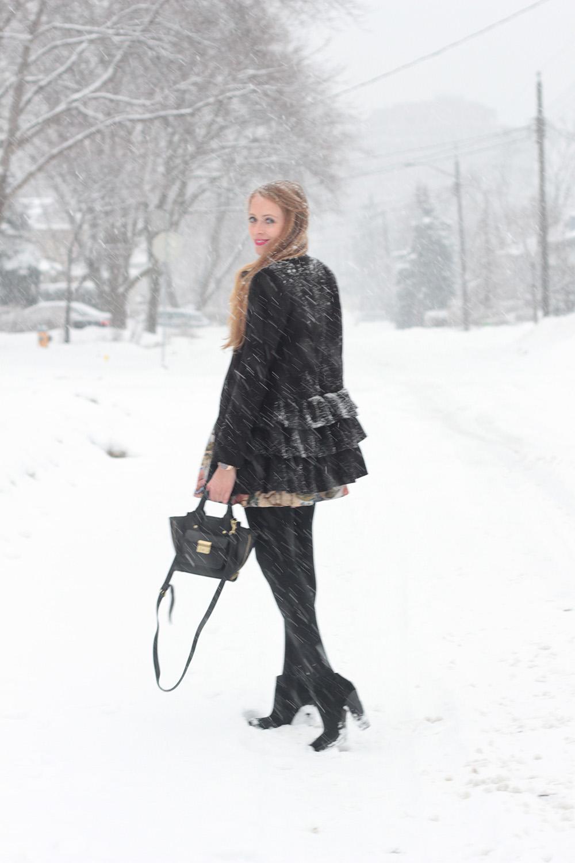 black ruffle coat