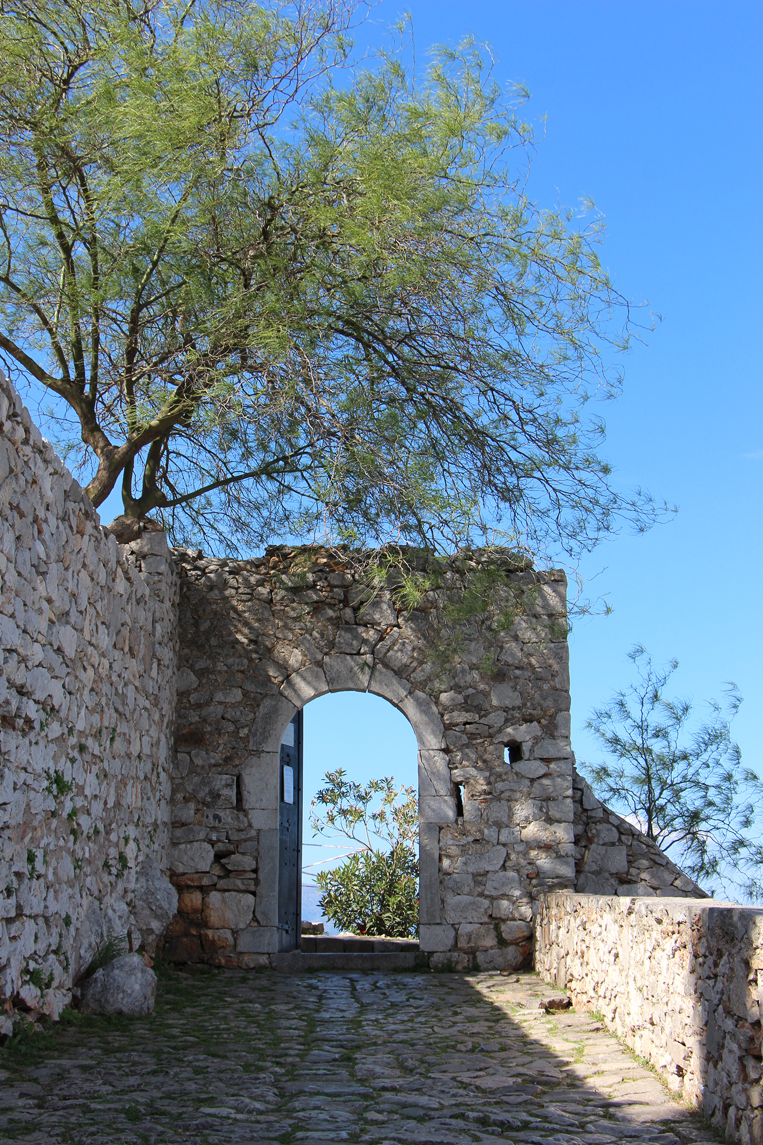 entrance to nafplio palamidi fortress shadows trees