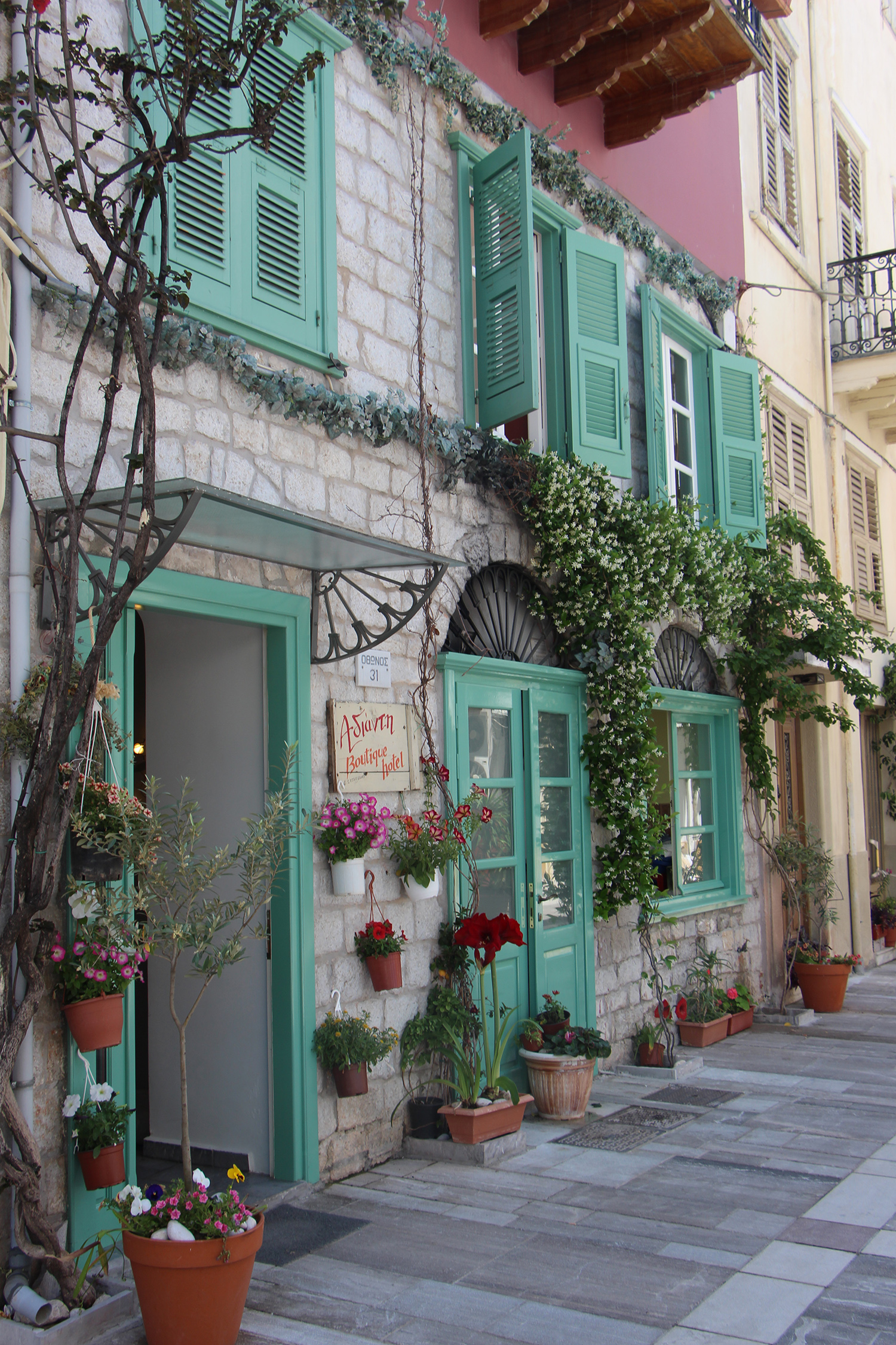 nafplio greece turquoise house pretty building