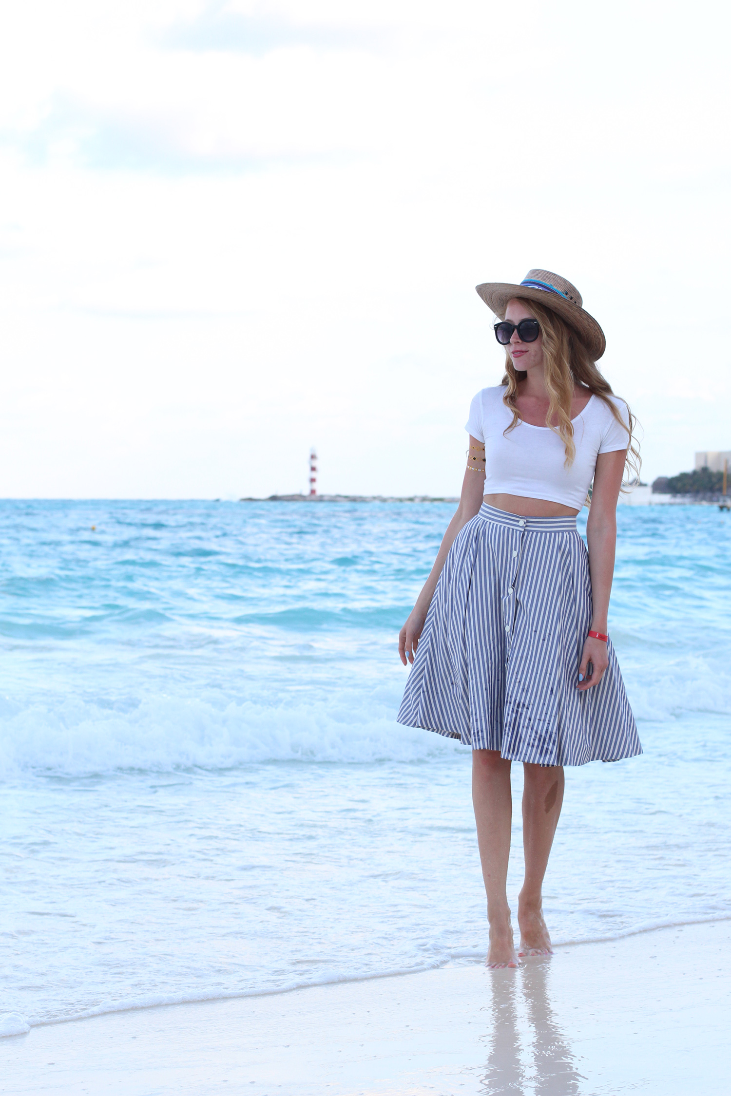 white crop top blue and white striped skirt