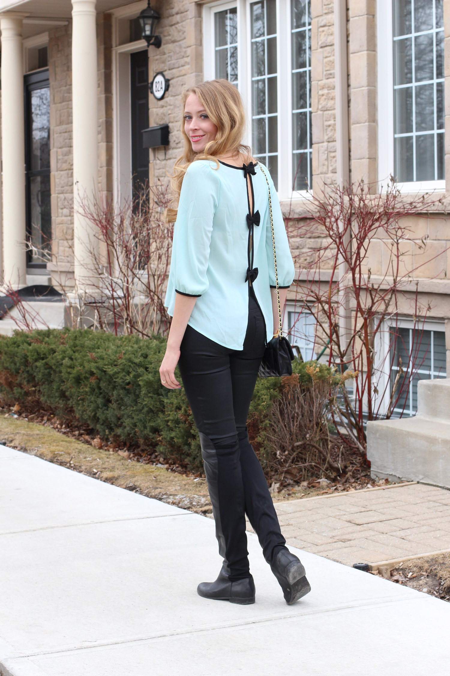 mint bow blouse black jeans outfit
