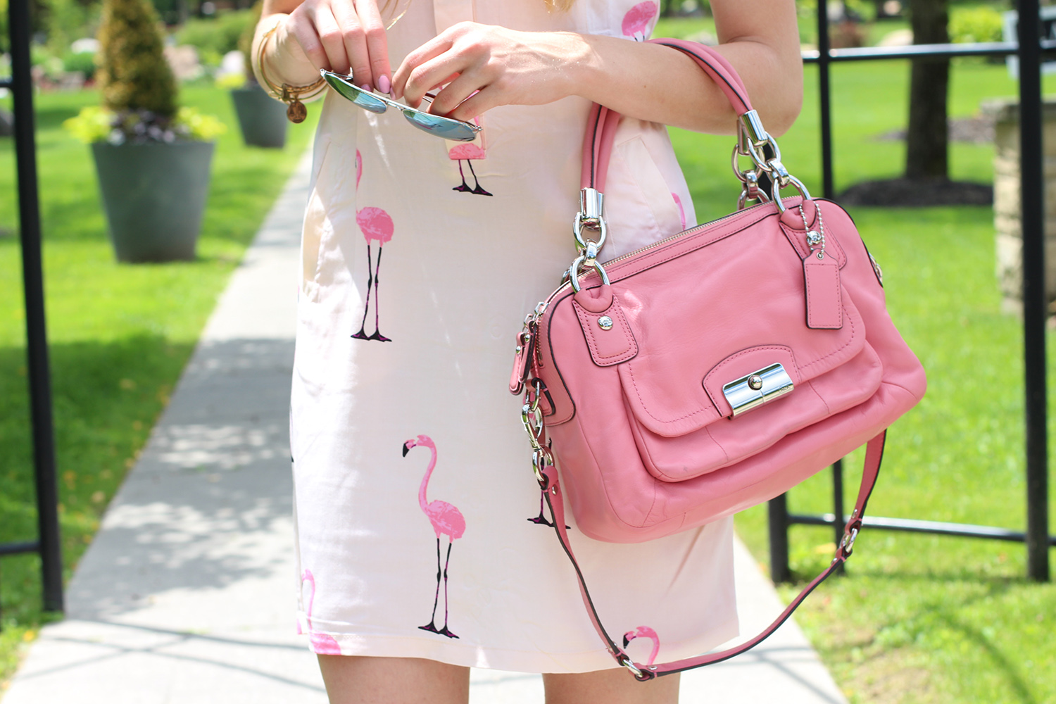 flamingo print dress pink coach bag