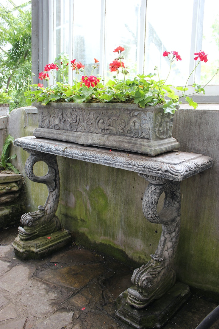 antique table and red geraniums