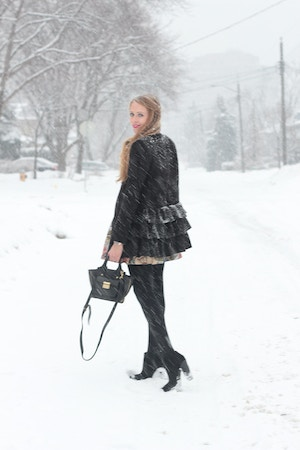 black ruffle coat