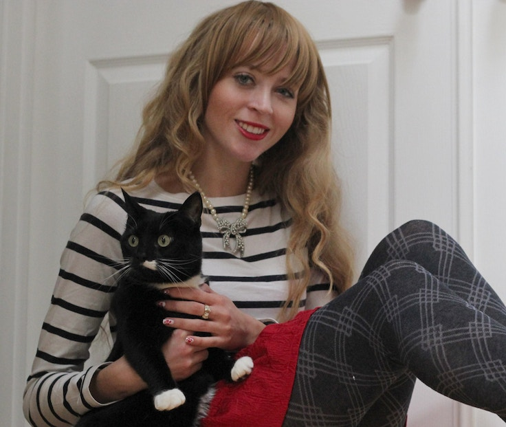 black and white cat nautical striped sweater girl with bangs