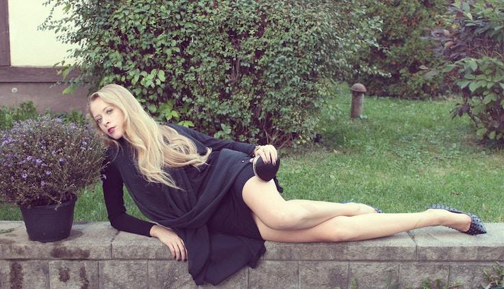 spiked stilettos black drapey dress chiffon heart clutch