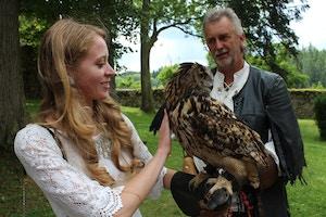 girl holding an owl