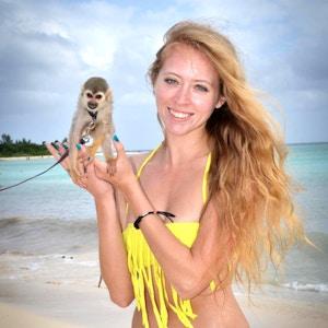 girl in bikini with a spider monkey