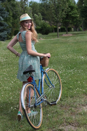 girl in green dress with bike
