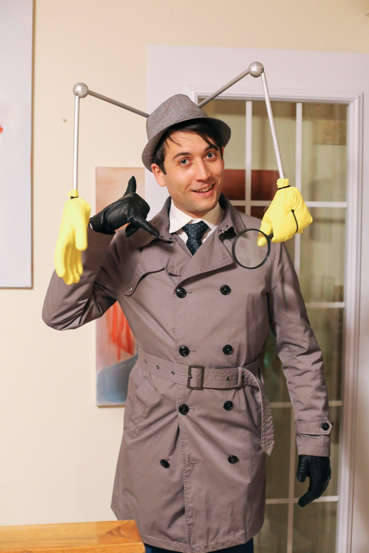 Inspector Gadget DIY Halloween Costume: to make this Inspector Gadget hat you need a fedora, wooden dowels, styrofoam balls, a magnifying glass and rubber gloves.