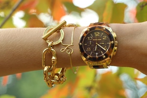 gold and tortoiseshell michael kors watch