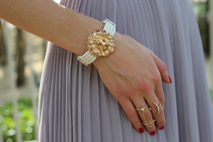 gold lion bracelet and rings