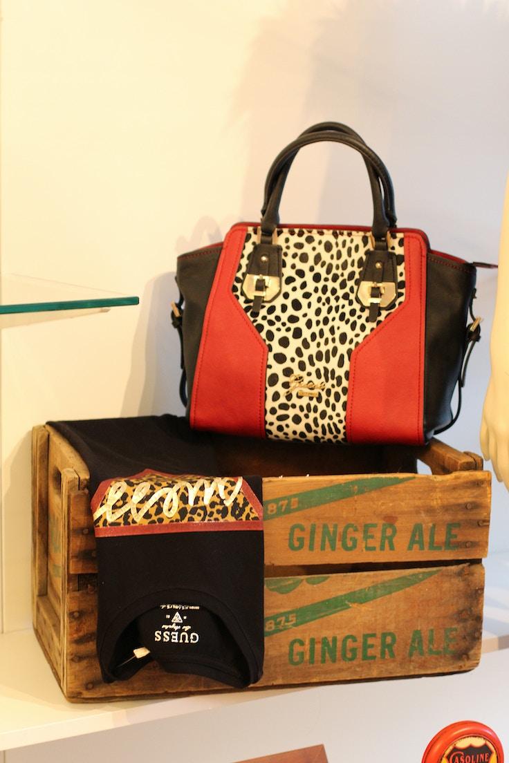 guess dalmatian and red handbag