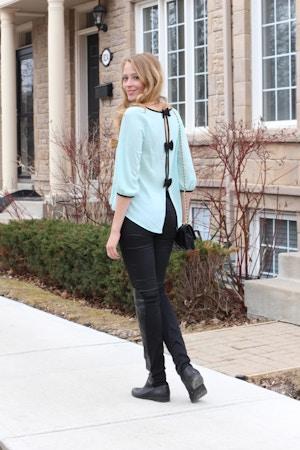 mint bow blouse black jeans outfit