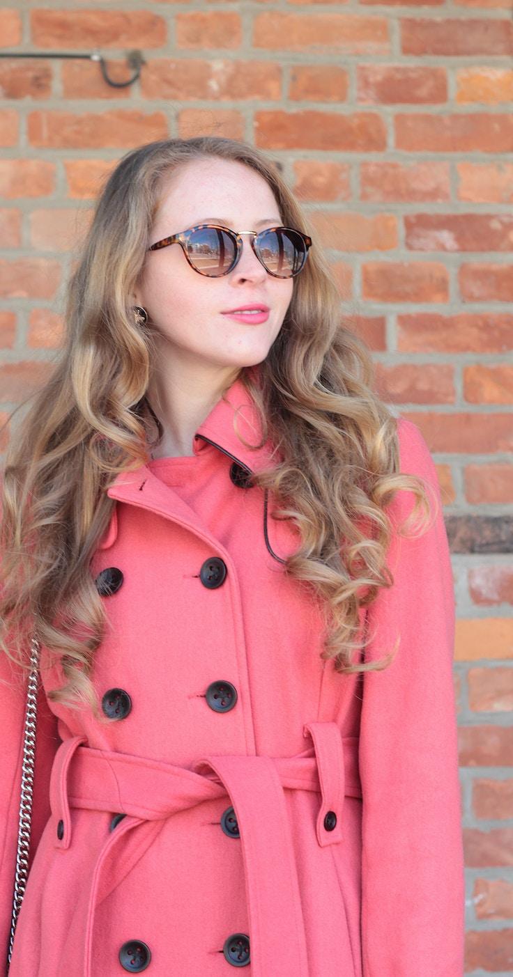 pink coat tortoiseshell sunglasses