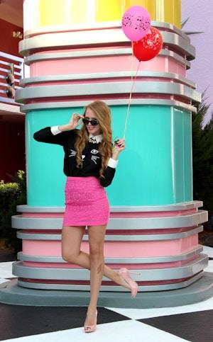 pink skirt cat shirt balloons