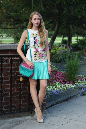 pleated skirt and floral blouse