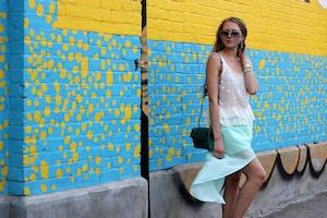 white top blue skirt