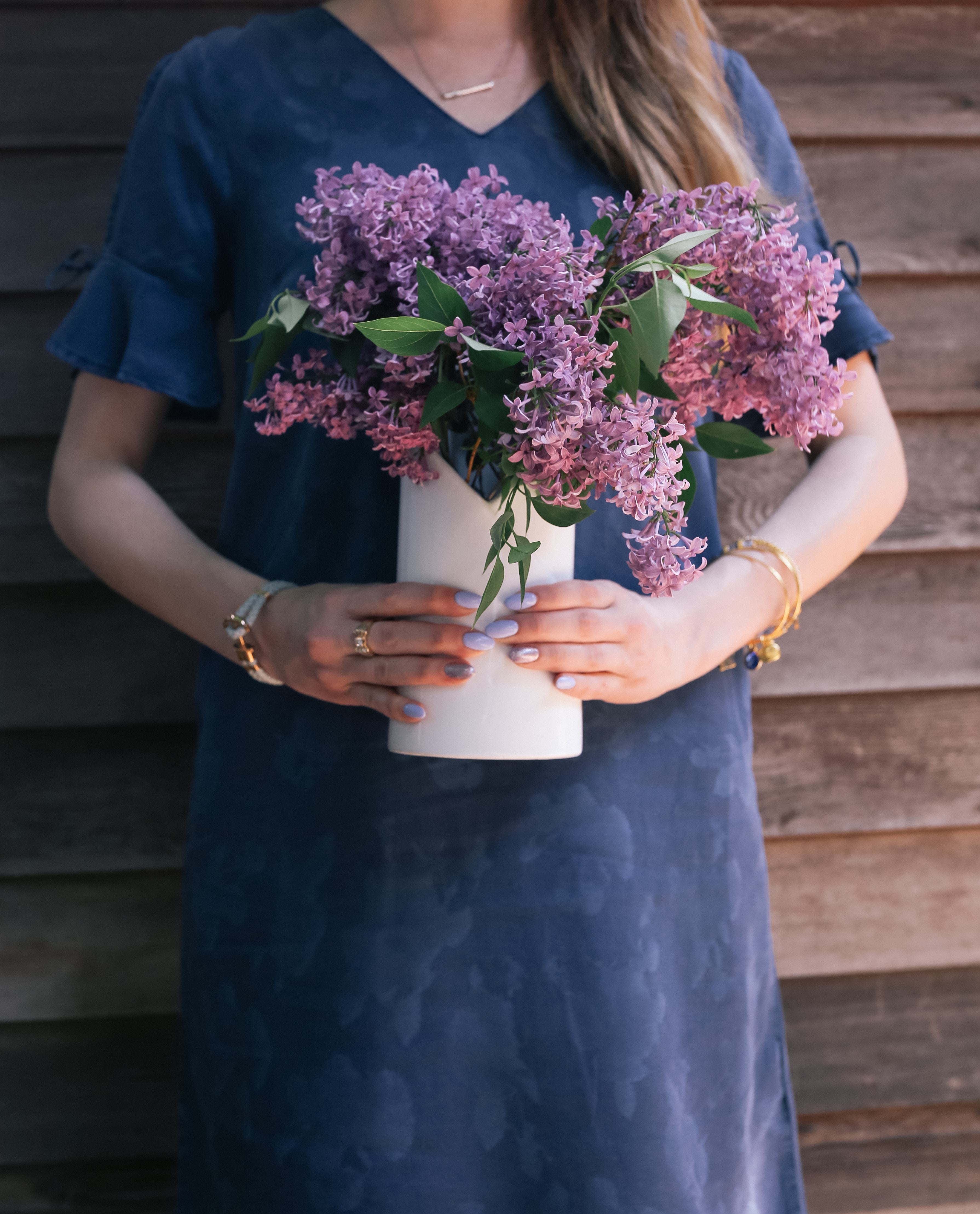 denim dress and lilac bouquet