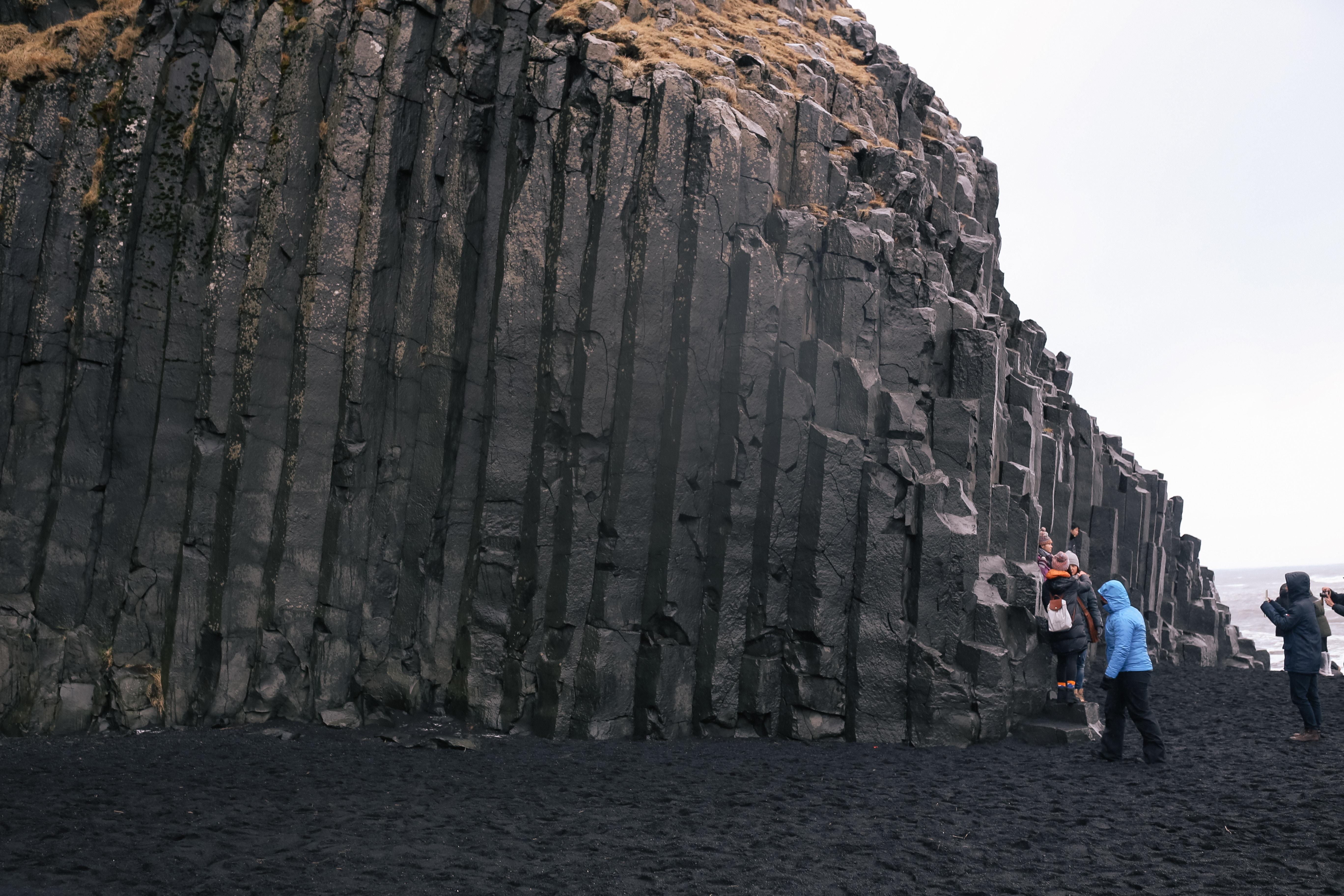 Southern Iceland Vik Travel Itinerary: Impressive basalt columns at Reynisfjara Beach aka Iceland's black beach.
