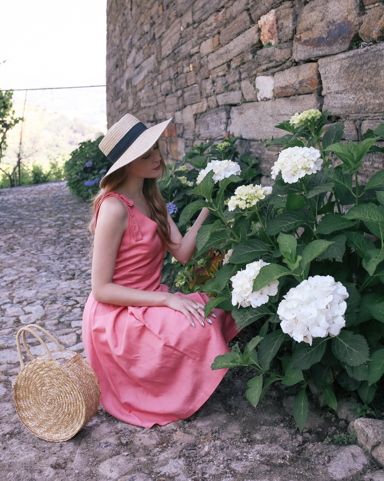pink linen dress with straw accessories summer outfit