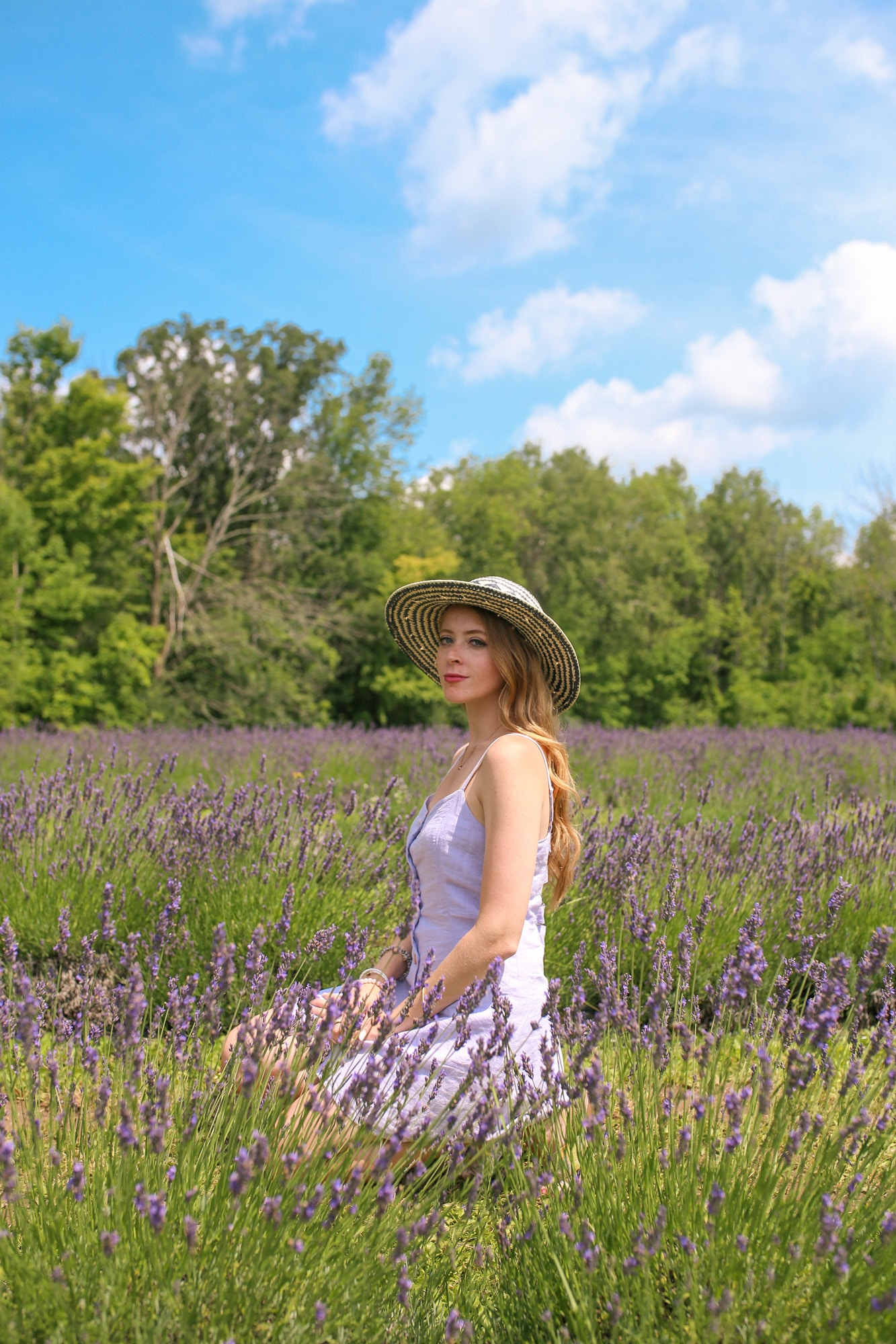 Straw hat and purple linen dress from Urban Outfitters | What to wear to a Lavender field - stay cool in a light linen dress and sunhat.