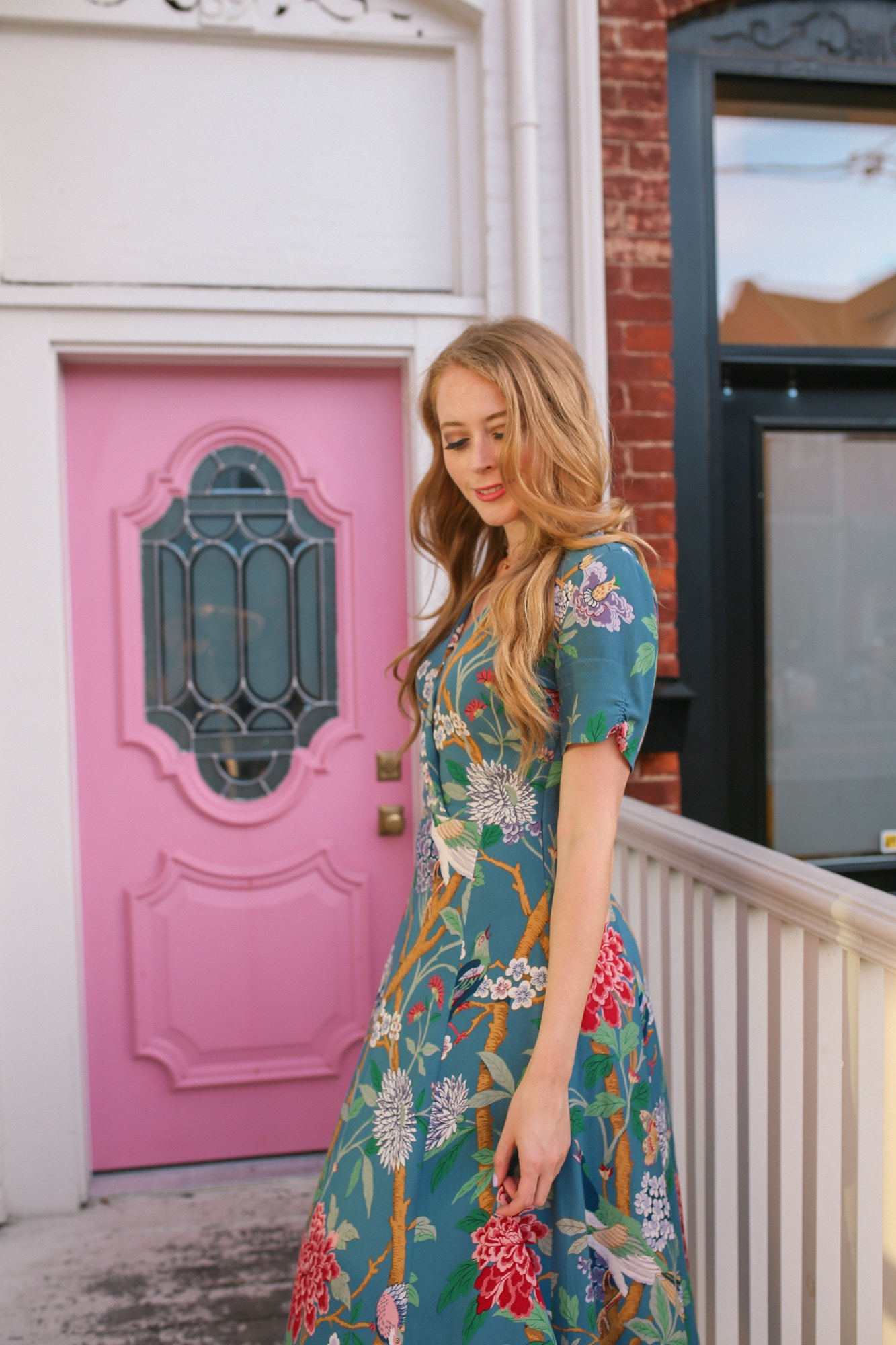 Wearing a GP & J Baker dress in blue. This gorgeous dress inspired by wallpaper prints is perfect for dinner dates or even a casual wedding.