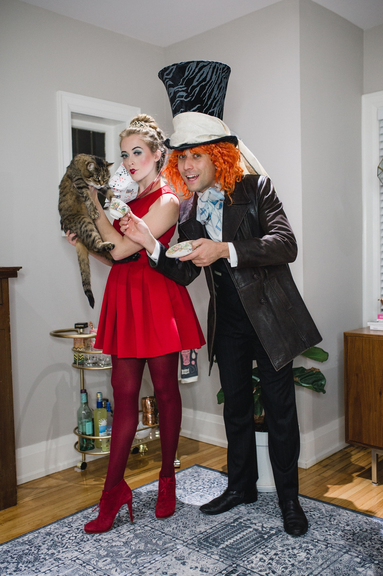 Alice in Wonderland couples halloween costume: Mad Hatter, Queen of Hearts and the Cheshire Cat