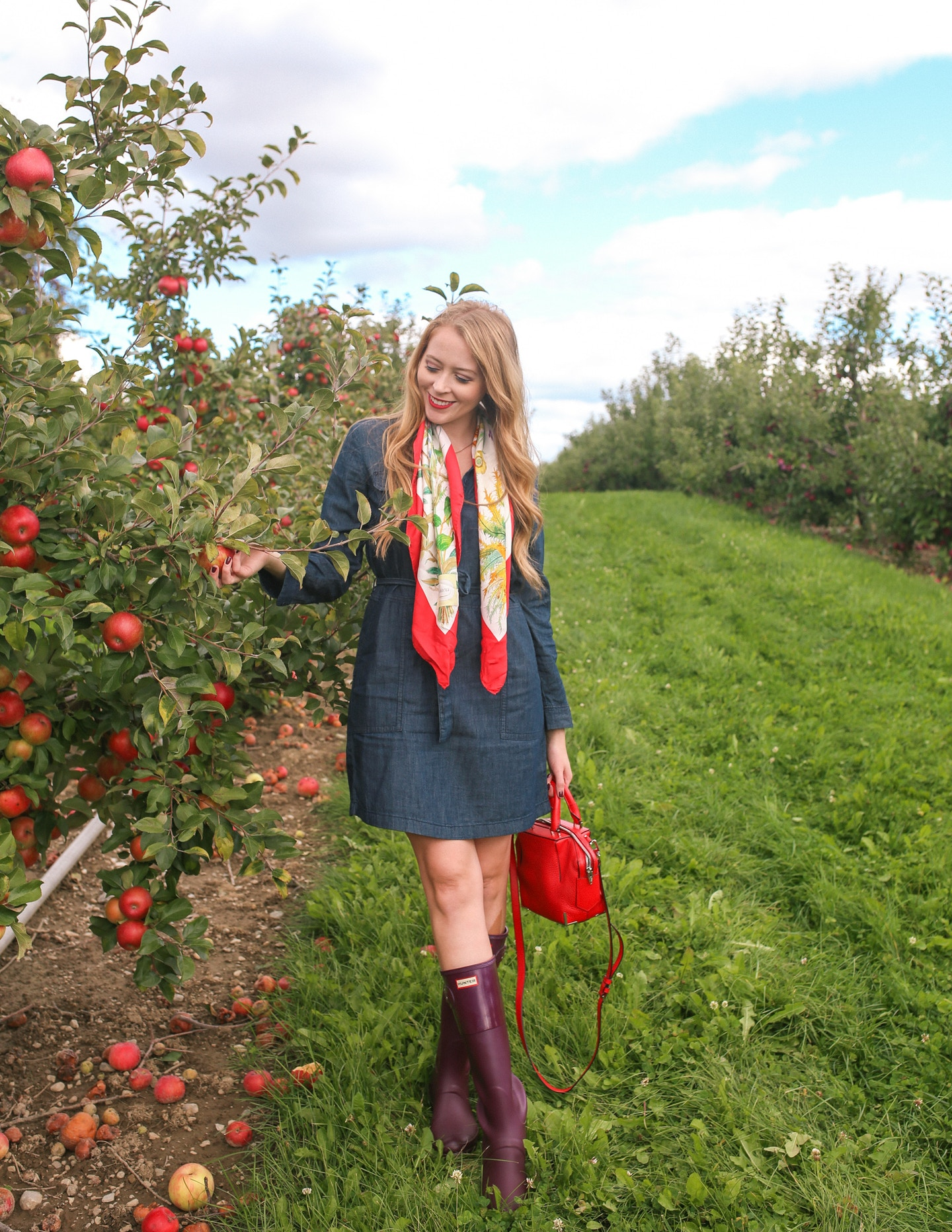 What to wear to go apple picking near Toronto: a denim dress, tall Hunter boots and a vintage Gucci silk scarf is a chic fall outfit idea.