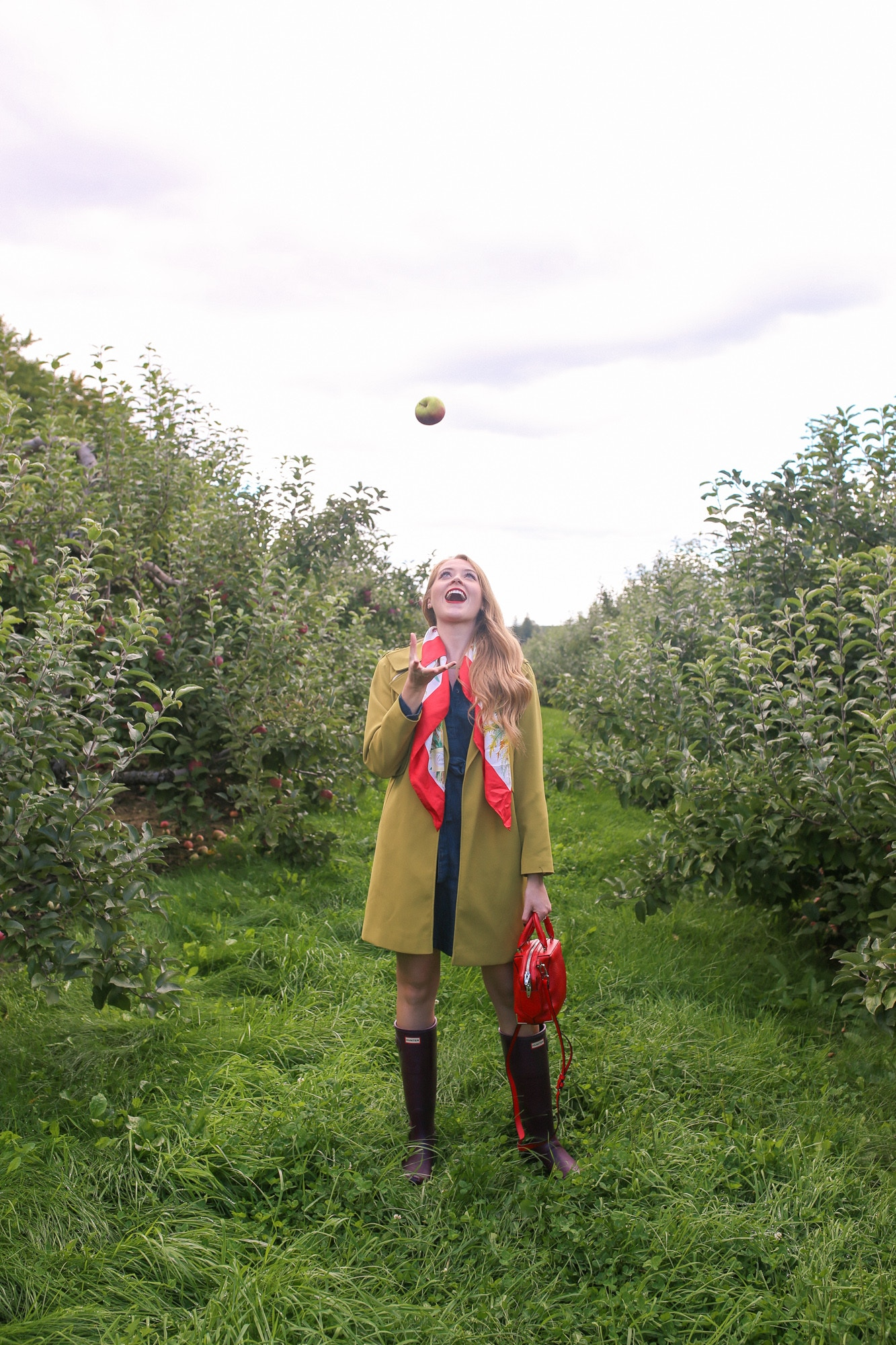 Apple picking near Toronto: Applewood Farm Winery. I wore a chartreuse trench and silk scarf and Hunter Boots for a chic, practical fall outfit.