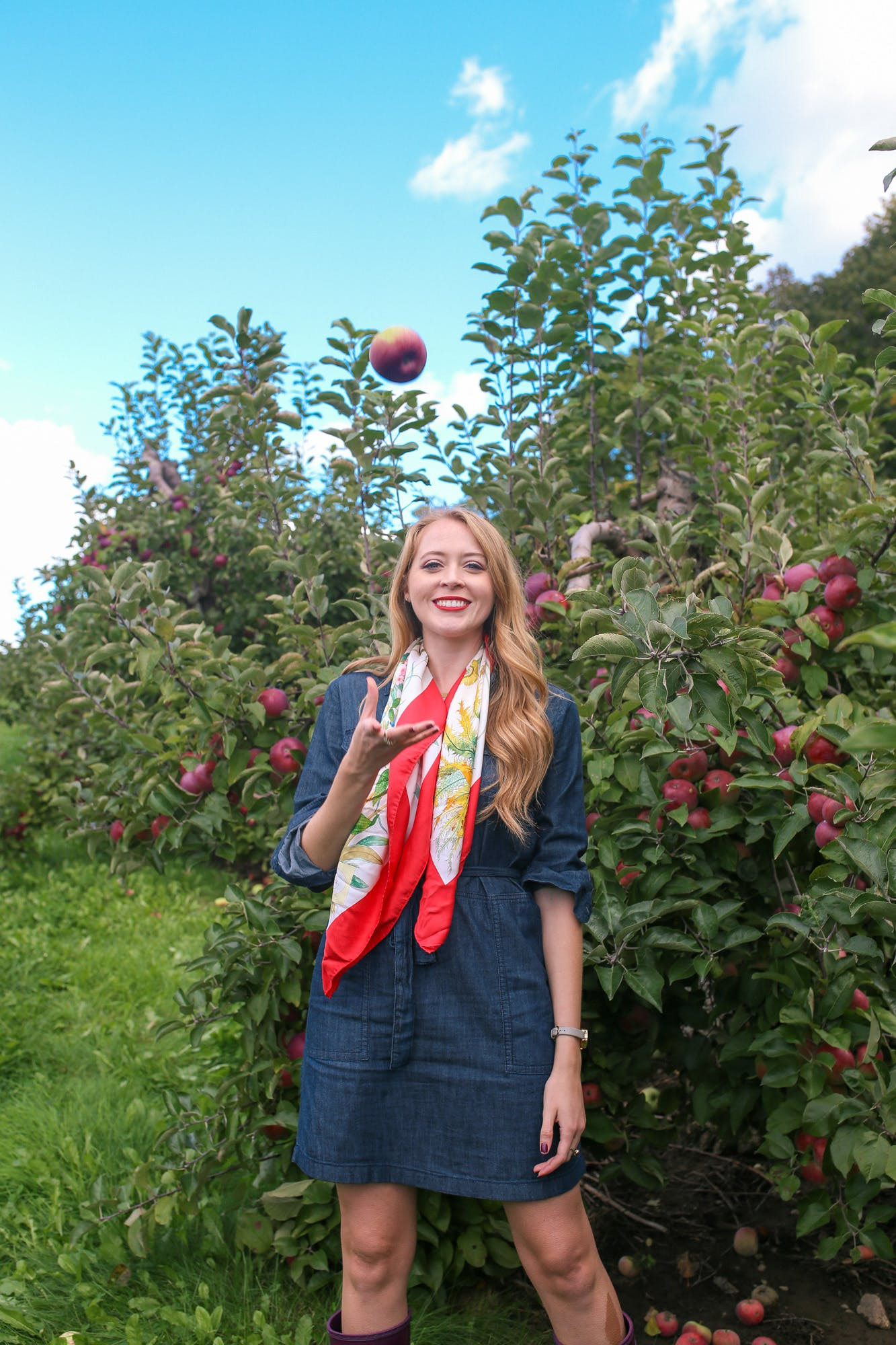 Apple picking outfit idea: denim dress and silk scarf