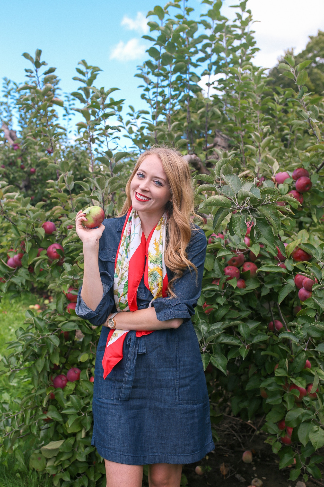 Apple picking outfit: a casual denim dress is more sophisticated with a vintage silk scarf in a festive fall colour.