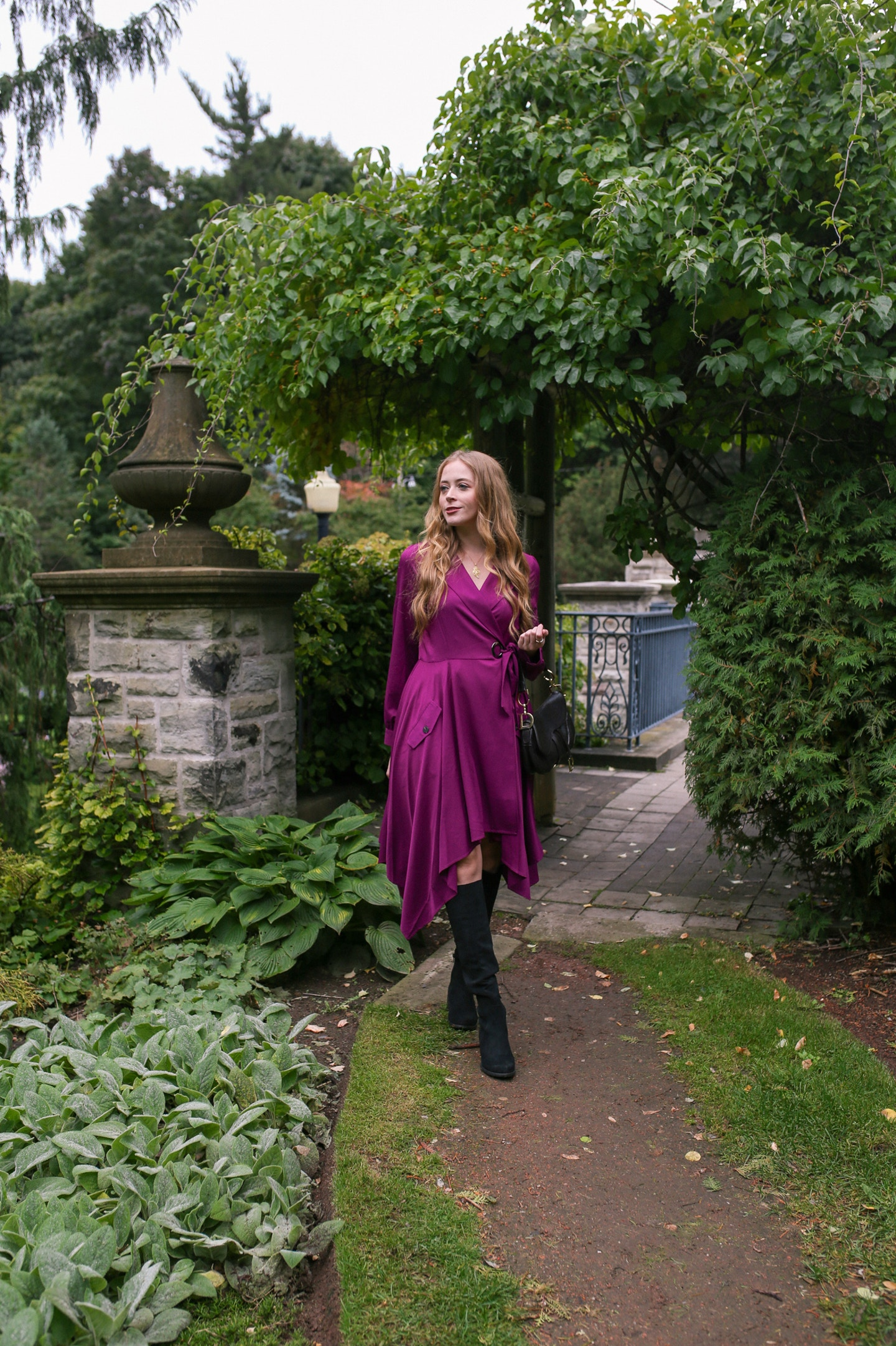 How to wear tall black boots with a dress: styled a pair of Unisa Indyia over the knee boots with a Chriselle Lim Wren Trench dress for a chic fall look perfect for a concert or date night.