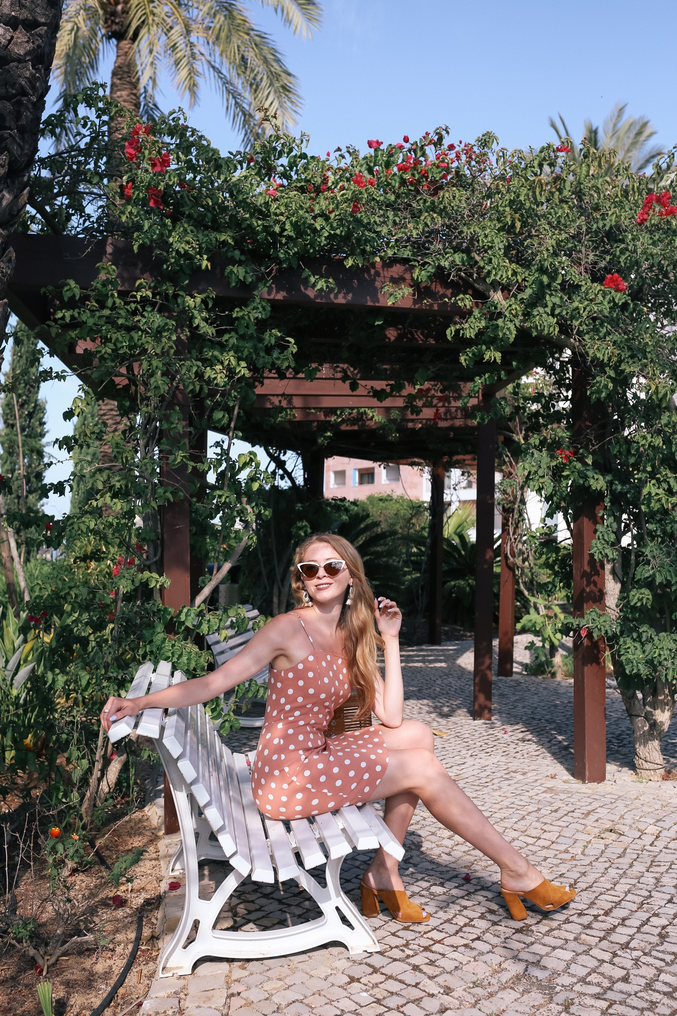 I wore this polka dot dress from Forever 21 with mules from Vince Camuto for a chic vacation look