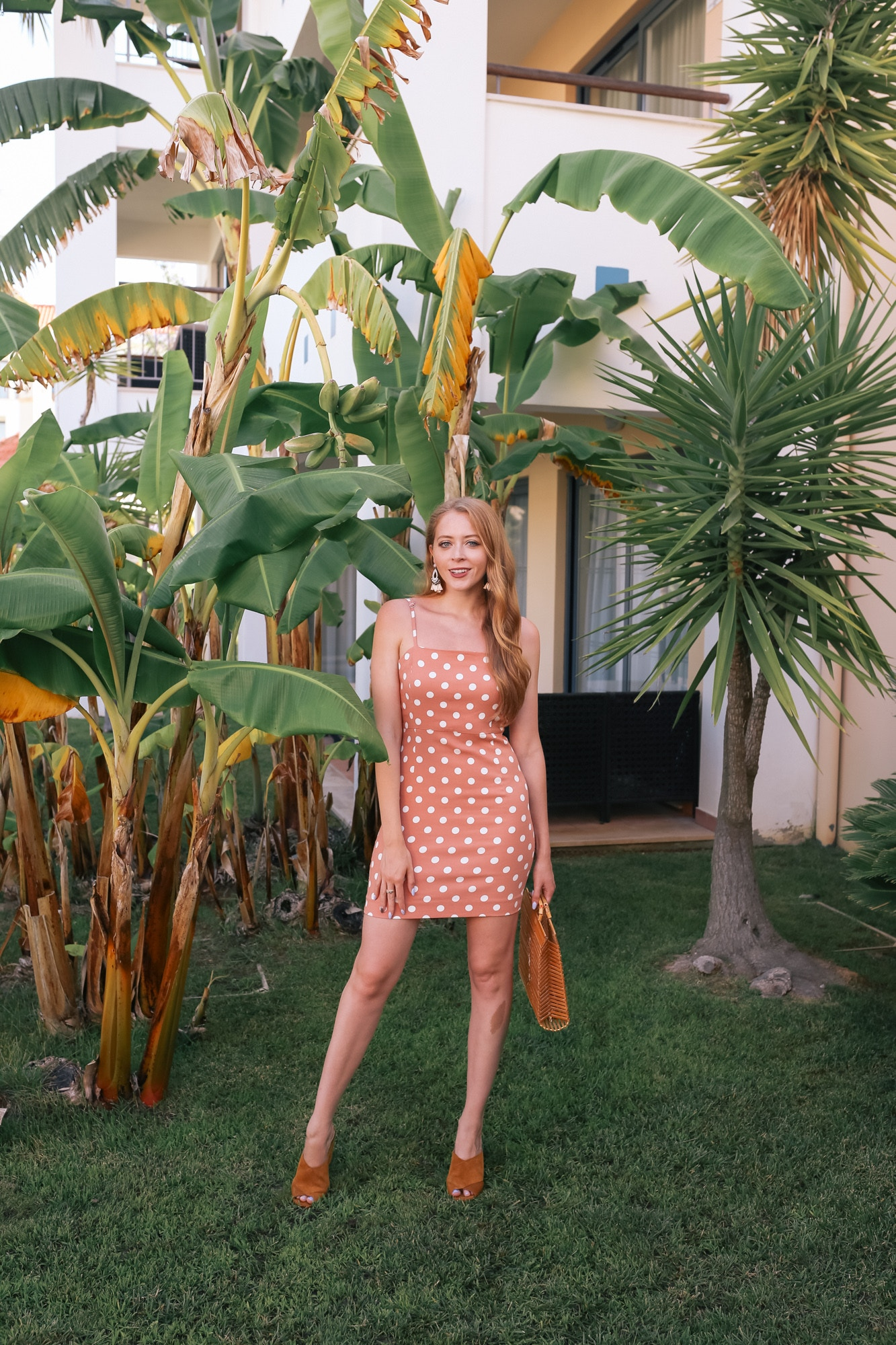 A chic polka dot spaghetti strap dress from Forever 21 is perfect for a tropical vacation. I wore this outfit to explore my hotel, Hilton Vilamoura As Cascatas Golf Resort & Spa during my recent trip to Portugal.