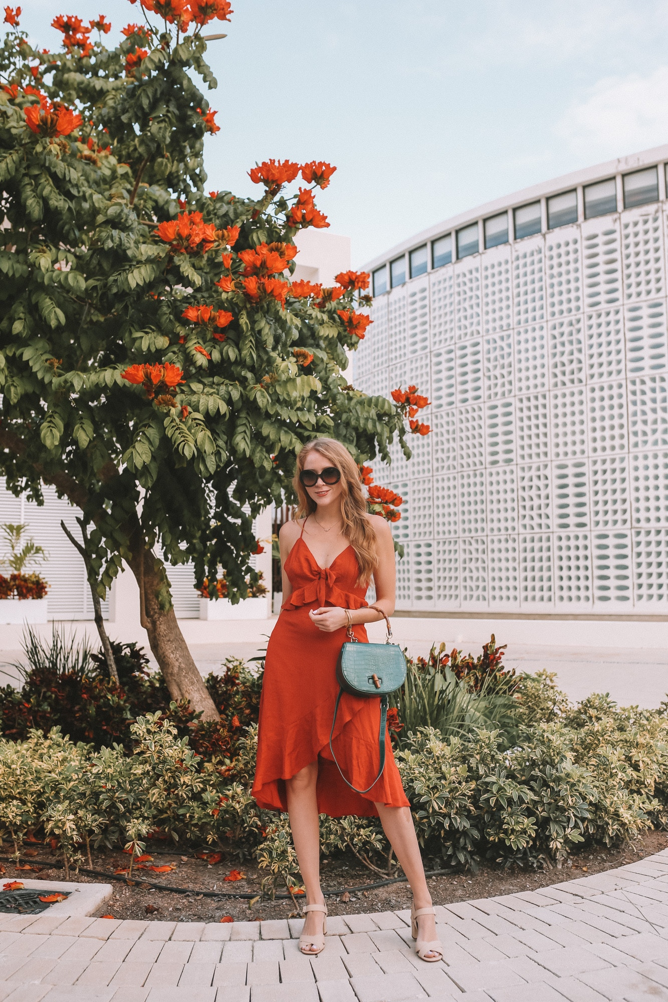 What to wear in the Mayan Riviera? I'm sharing this orange linen dress and statement accessories as outfit inspiration, as well as a packing list for a chic resort wear wardrobe that's perfect for visiting Mexico in winter!