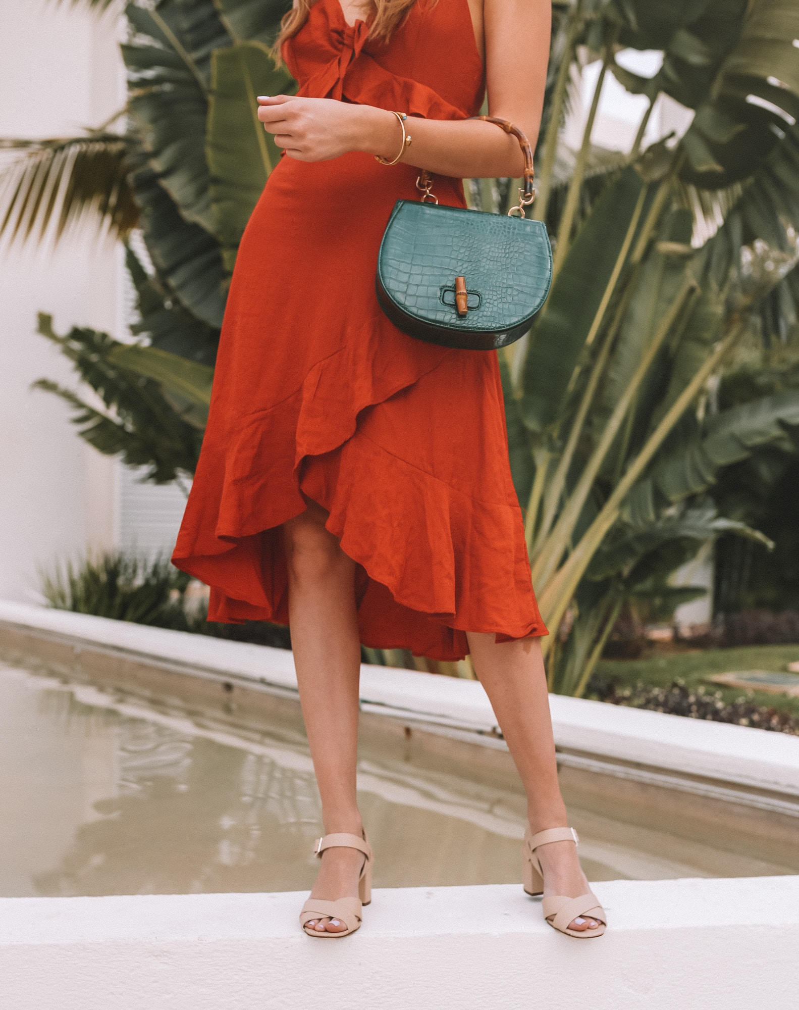 Forever 21 green faux croc bag with a bamboo handle, orange linen dress and cream leather sandals.