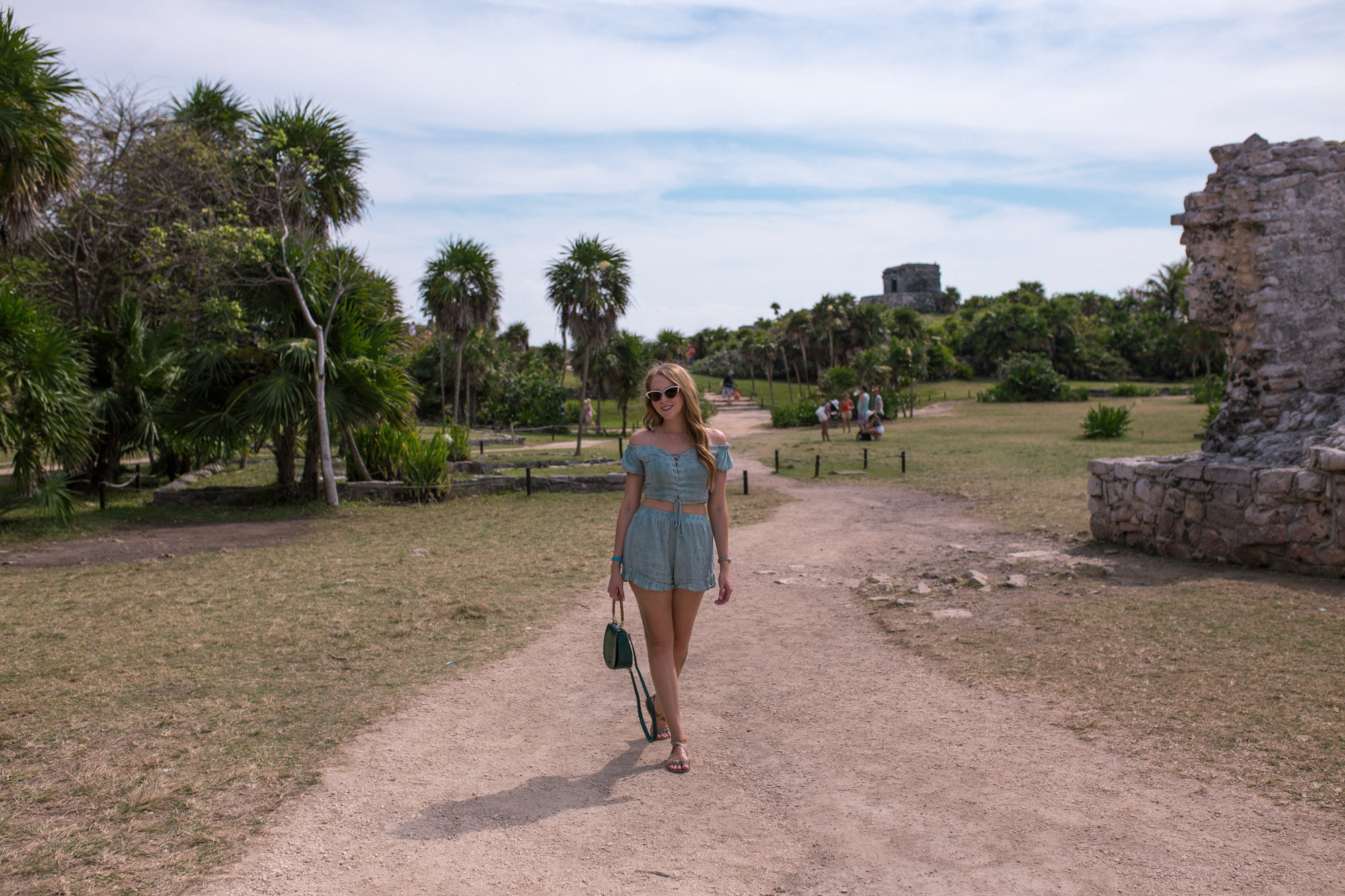 10 Helpful Tips for visiting Tulum - dress light and bring sunscreen, water and a towel. I wore this light two-piece set from Forever 21 and leather sandals to stay cool.