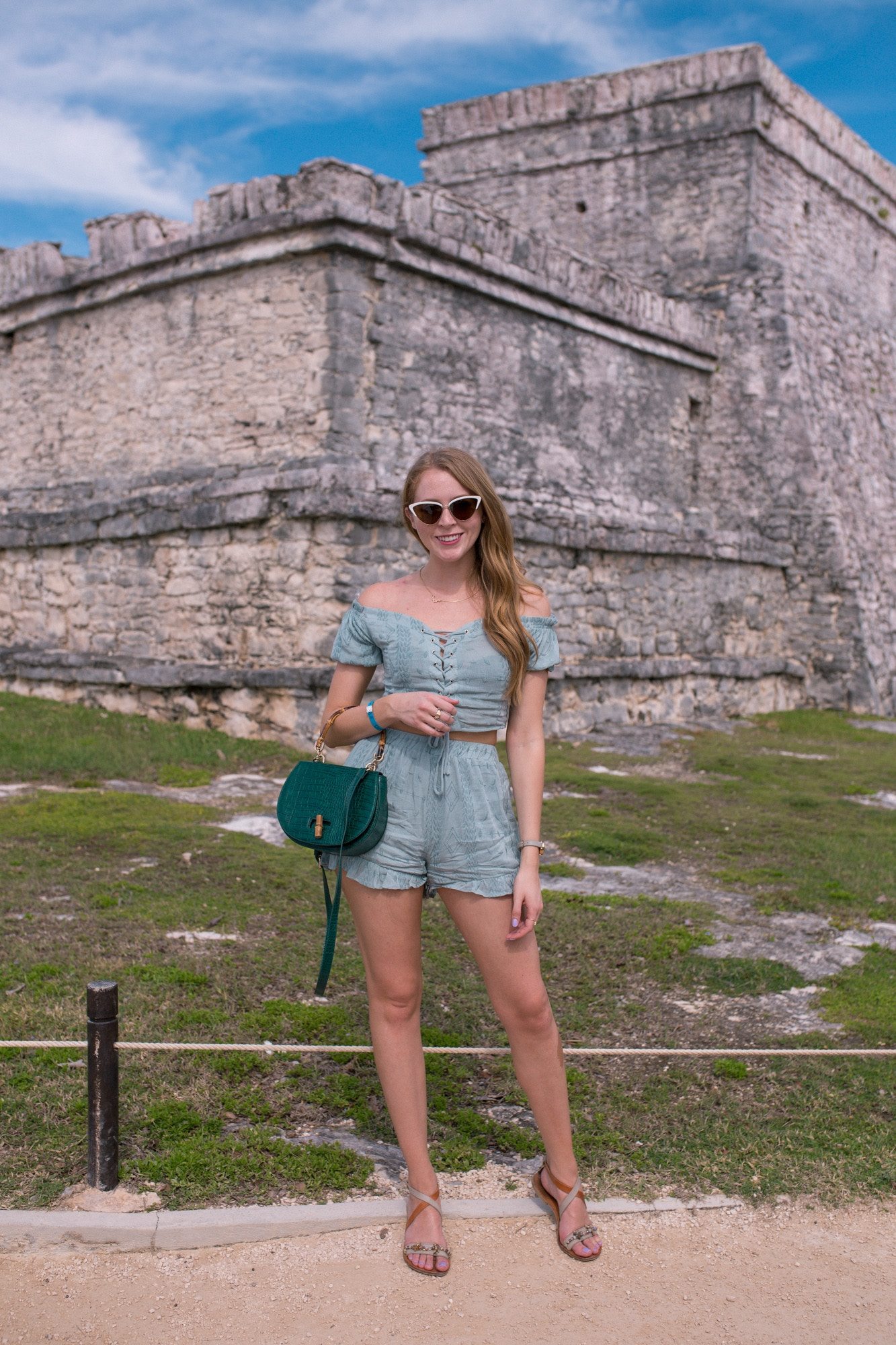 What I wore to visit the Tulum archeological site. This crop top and shorts set from Forever 21 is so light and easy to wear! I paired it with a bamboo bag and white sunglasses.