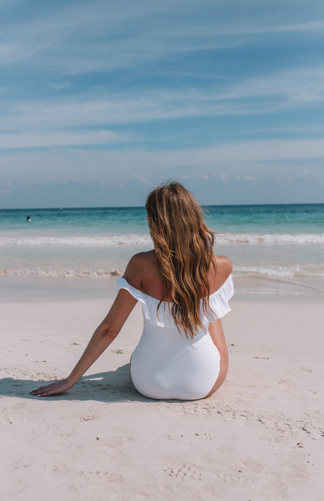 Tulum Playa Paraiso Beach - I wore a white off the shoulder one piece swimsuit from La Vie en Rose to relax on the white sandy beach of Tulum, Mexico.
