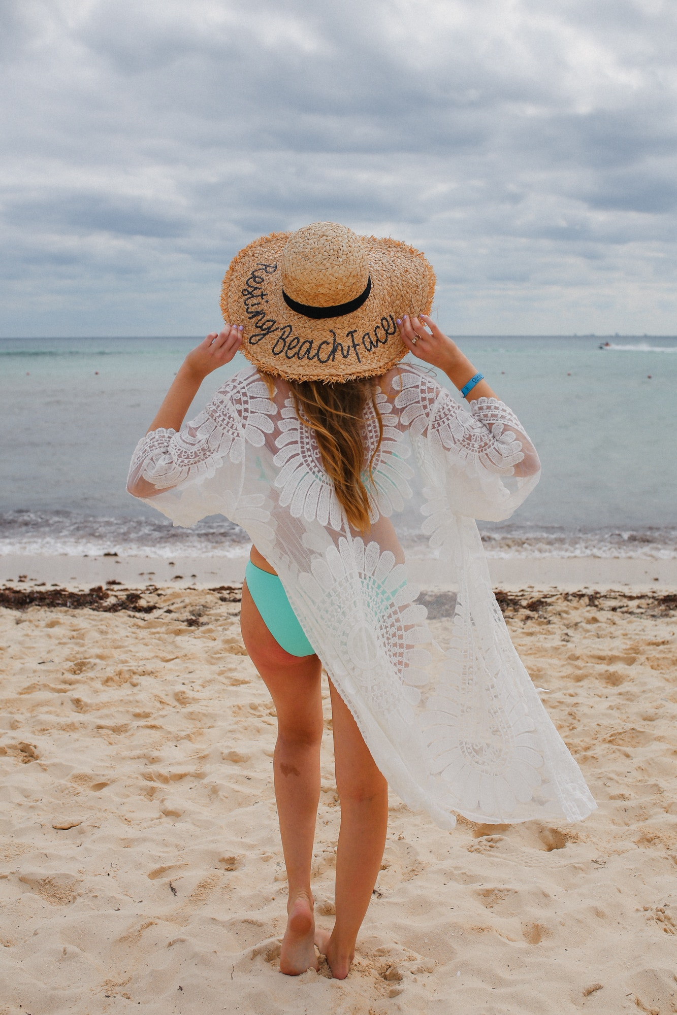 This white lace beach coverup from Amazon is a must-buy! I love how inexpensive it is and it's so chic! Also wearing a Resting Beach Face sunhat for a cheeky resort look.