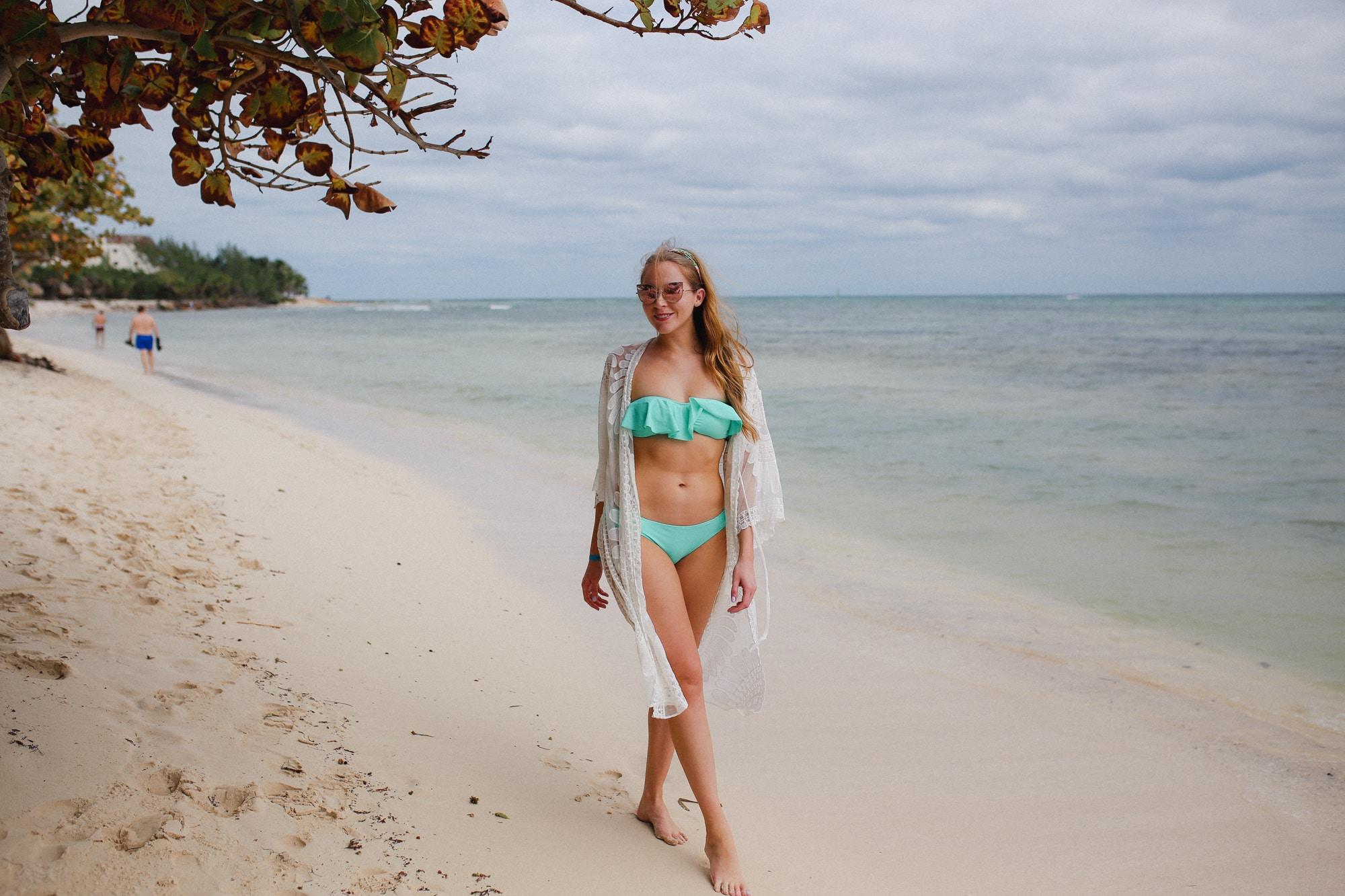 Aqua Victoria's Secret bathing suit and white lace Amazon coverup.