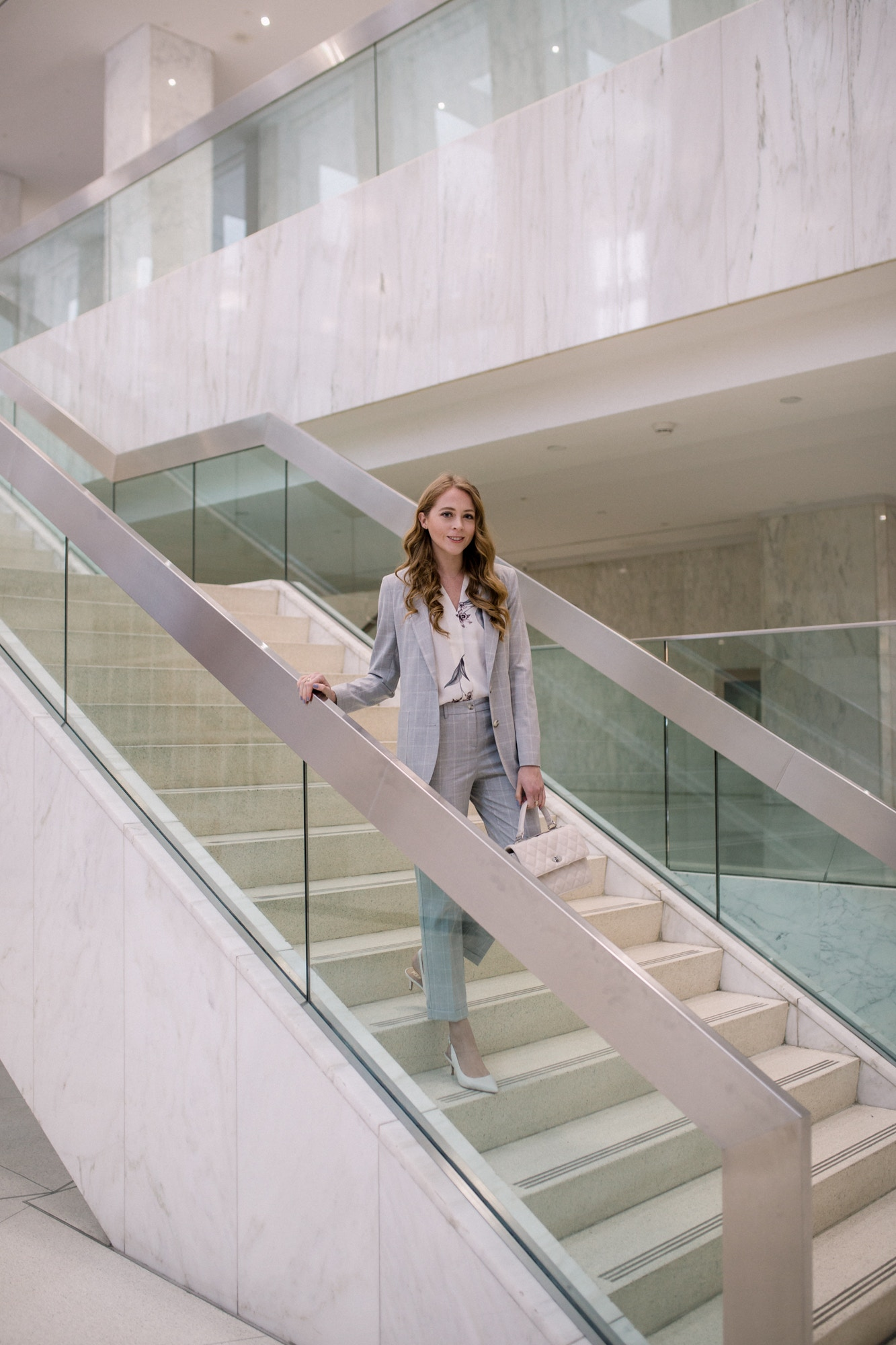Chic grey suit for corporate work environment. Dressing for the office can be a challenge, but a sleek classic suit in a modern cut is easy to wear. This grey plaid suit from Le Chateau is easy to dress up or down.