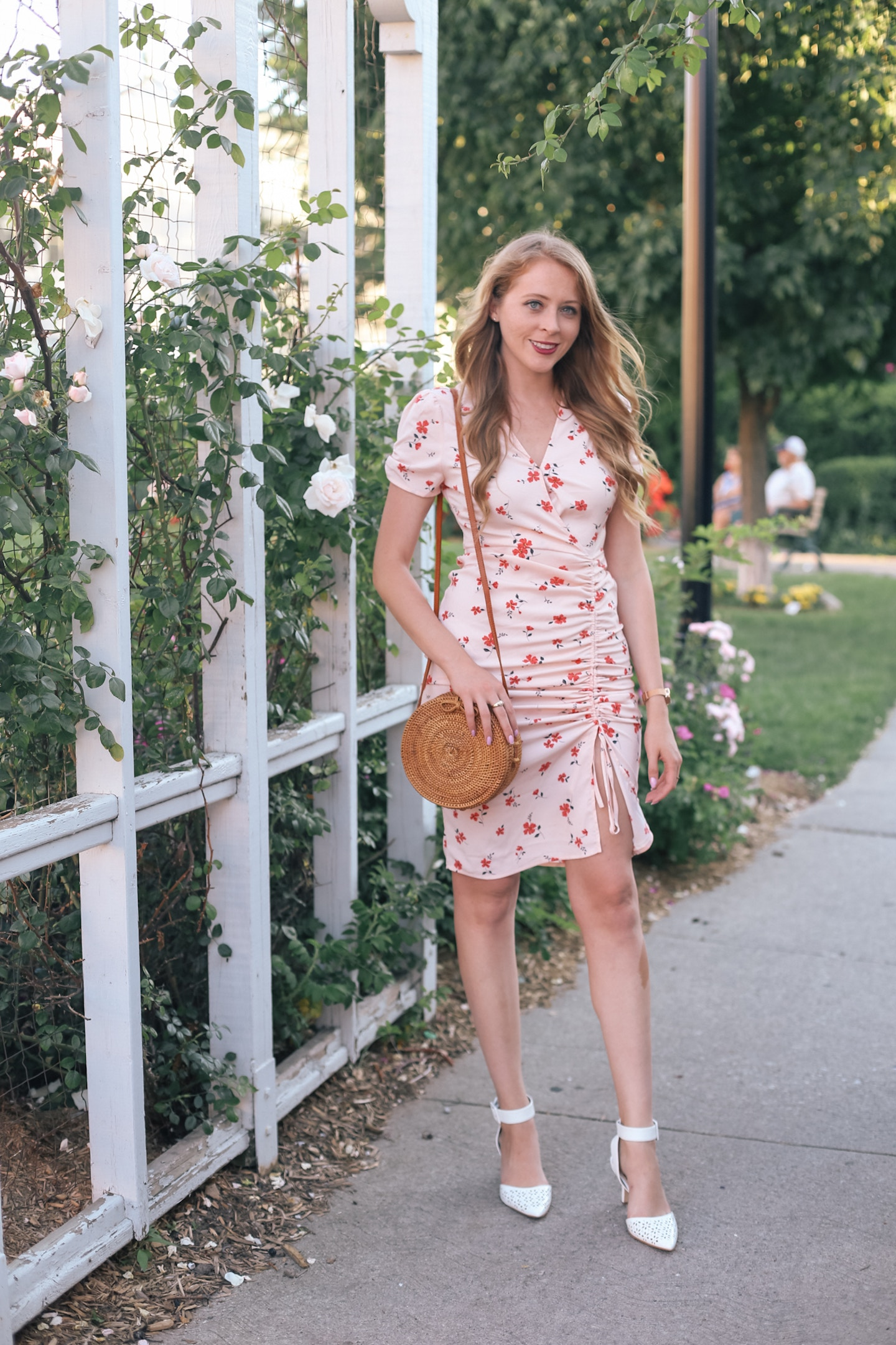 J.O.A. Cinch Front Dress: a cute cinched dress with a dainty rose print pairs perfectly with white pumps and a rattan round bag for a late summer look.