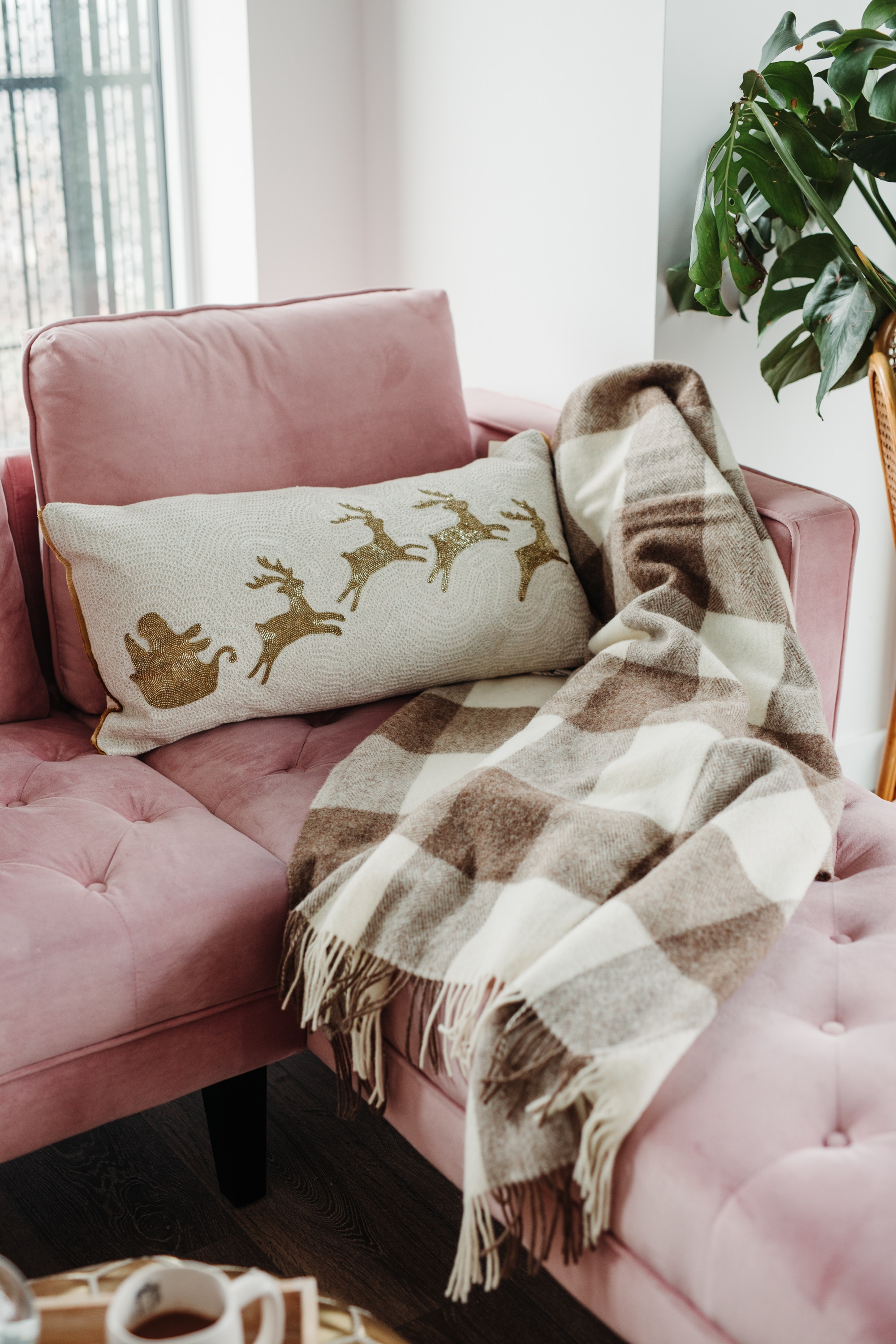 Beaded Santa sleigh couch pillow, wool throw - Christmas styling ideas for your couch